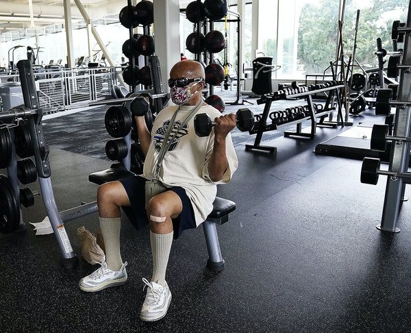 The Midway YMCA was one of two of the first YMCAs to reopen June 10 at 25% capacity. Here, Bobby Richardson of St. Paul, who lifts weights five times