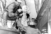 'Nine kids trapped upstairs' This photo appeared on the cover of the Minneapolis Tribune on April 14, 1952, of rescuer Ed Steffen lifting 1-year-o