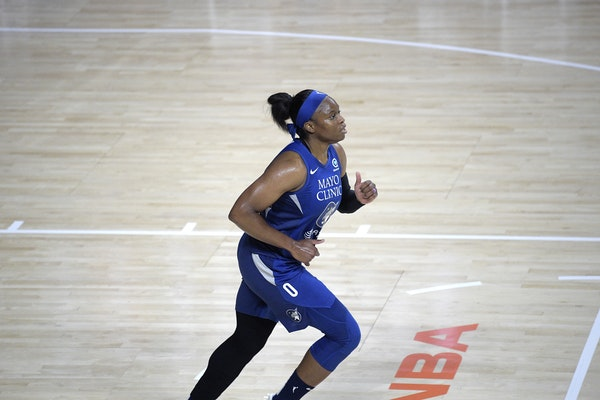 Minnesota Lynx guard Karima Christmas-Kelly (0) runs up the court during the first half of a WNBA basketball game against the Connecticut Sun, Sunday,