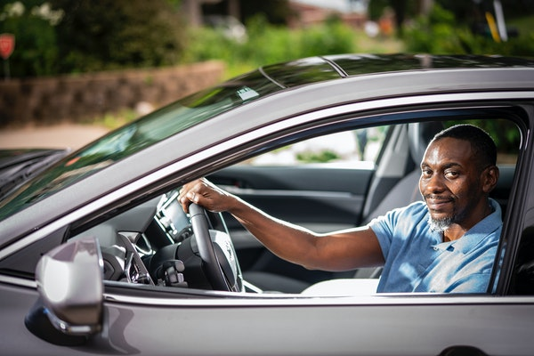 Andre Roberson, a companion driver for 'Lifesprk GO!! Powered by Envoy America,' a senior transportation service, posed for a portrait in his car