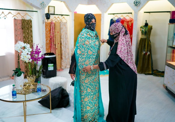 Sabrina Seyf, owner of Sabrina's Bridal, worked with a bride-to-be in her store at Karmel Mall in Minneapolis.