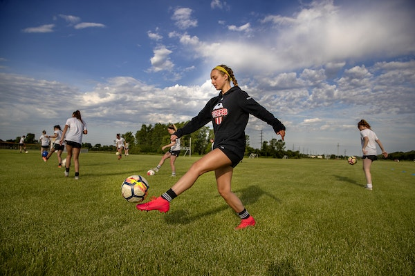 Farmington girls' soccer captain Bailey McCuddin and her teammates participated in practice at Dodge Middle School on June 15, the first available d