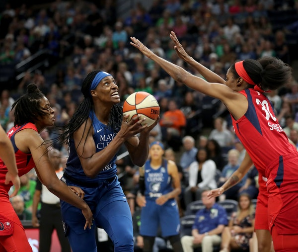 The Lynx's Sylvia Fowles drives on the Washington Mystics' Latoya Sanders during the first half of a game last August.