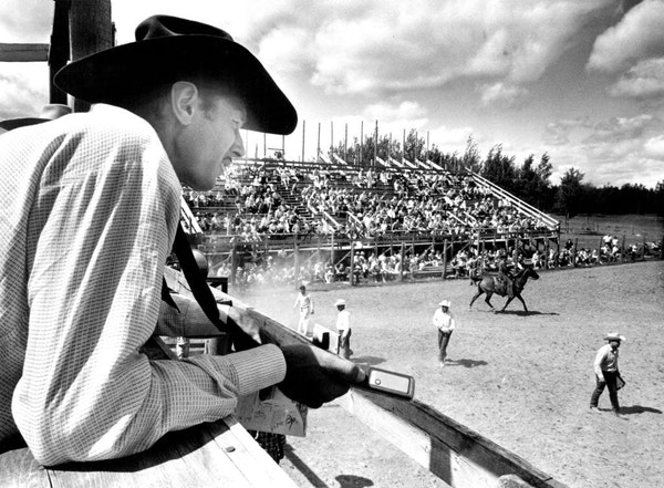 This year's North Star Stampede rodeo will be held without spectators. Here, founder Howard Pitzen announces the action in 1965.