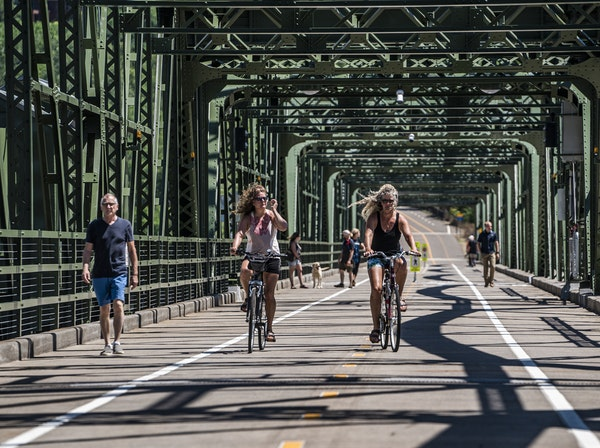 Bikers crossed the historic Stillwater Lift Bridge, now exclusively for pedestrians and bikers. Finally connected by a historic bridge and opened to t