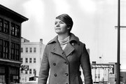 """Molly Ivins, Minneapolis Tribune reporter, insisted in 1969 that her new, red maxicoat was no fashion statement: """"I honest to God bought the thing b"""