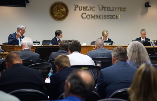 A Public Utilities Commission meeting on the proposed Enbridge pipeline in 2018 that had a full room of both advocates and opponents of the project.