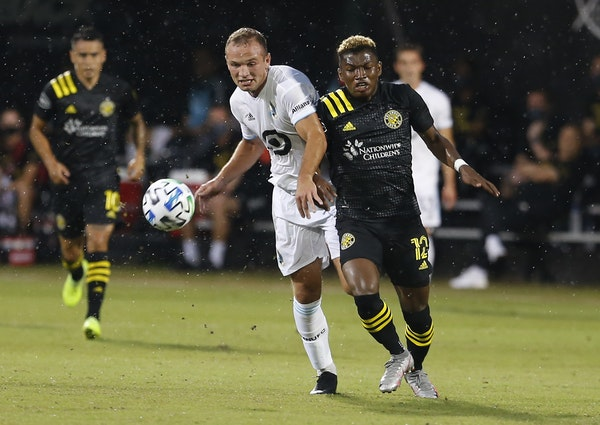 """Minnesota United defender Chase Gasper (left) battled Columbus Crew midfielder Luis Diaz (12) for the ball on Tuesday. """"Don't count out the Loons,"""