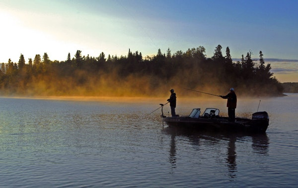 At sunrise or sunset, Lake of the Woods is a magnet for anglers