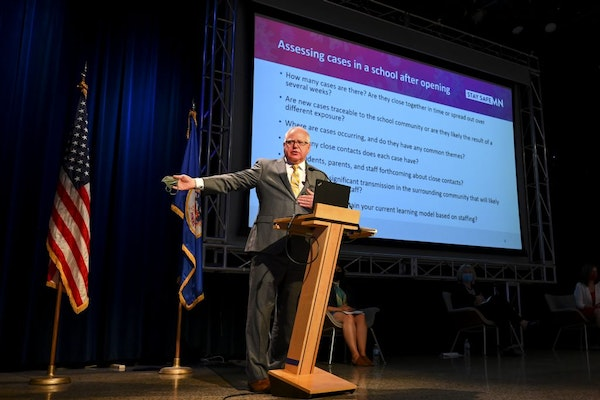 Minnesota Gov. Tim Walz takes part in a news conference Thursday in St. Paul to announce the learning plan for Minnesota schools for the upcoming acad
