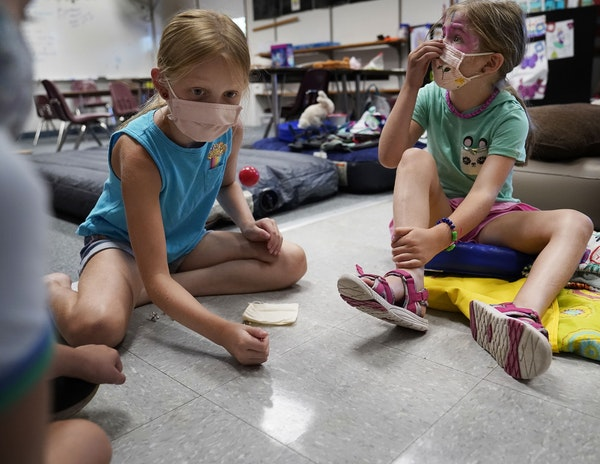 The Discovery Club summer childcare program is in session at Randolph Heights Elementary in St. Paul, where a game of jacks had kids active on Thursda