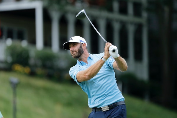 Dustin Johnson tees off on the 18th hole during the final round of the Travelers Championship