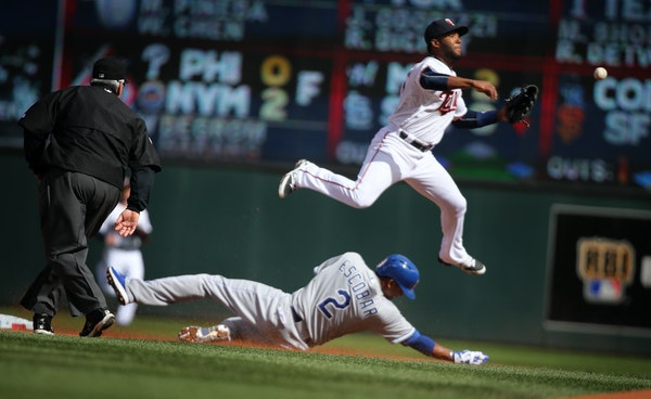 Danny Santana fails to make a double play from second base as Alcides Escobar of the Royals slides in safe during a game last season.
