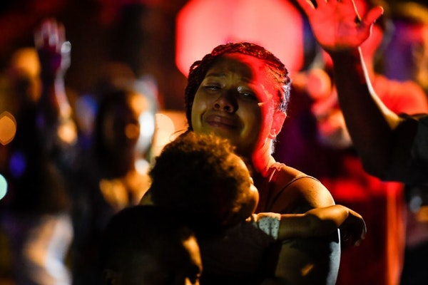 A woman was overcome with emotion during a prayer held for the man killed by Minneapolis Police hours earlier in North Minneapolis. She was part of an