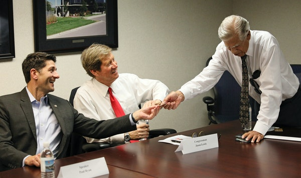 Dick Ames, right, met with then-congressmen Paul Ryan and Jason Lewis last July at Ames Construction in Burnsville.