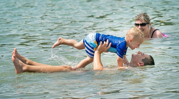 Easton Zarras, 2 was having a wonderful time playing with his brother Mitchell, 16 as they cooled off at SandVenture Aquatic Park in Shakopee.
