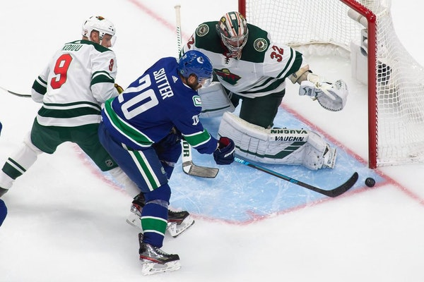 Vancouver Canucks' Brandon Sutter (20) takes a shot on Minnesota Wild goaltender Alex Stalock (32) during the second period of an NHL hockey playoff g