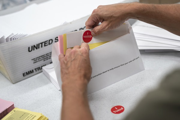 Todd Gallagher prepared mail-in ballot envelopes July 29, 2020, in Minneapolis.