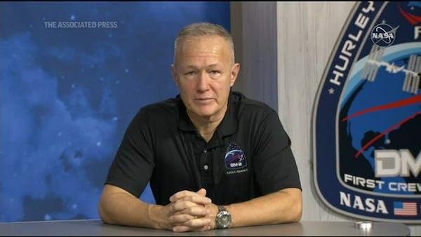 Astronauts describe wild ride in return to Earth