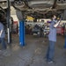 Mechanics Zach Stuen, right, and John Buttner work at the Lift Garage on East Lake Street, where many businesses were burned to the ground in May. The