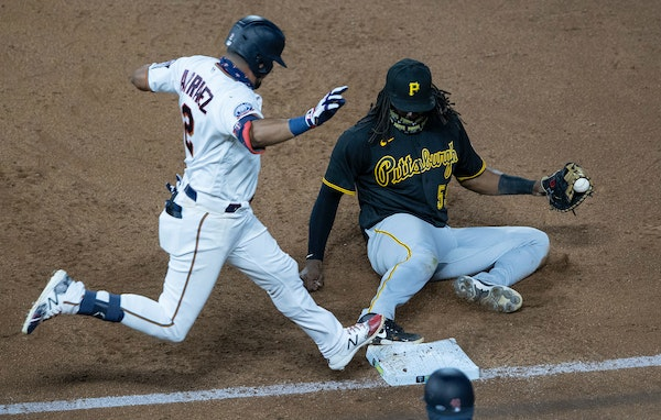 Pittsburgh Pirates First baseman Josh Bell slid into the bag to get Minnesota Twins Luis Arraez out in the sixth inning of Tuesday's game.