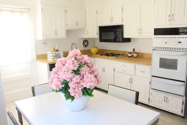 A new coat of paint gave this kitchen a refreshed look. Also consider upgrading appliances and flooring.
