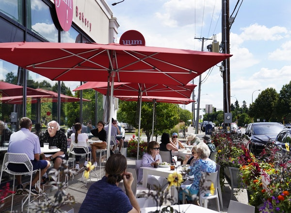 The outdoor lunch crowd at Yum! Kitchen and Bakery in St. Louis Park.