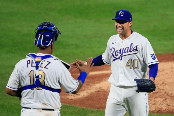 Kansas City catcher Salvador Perez and pitcher Trevor Rosenthal celebrate after Friday's game against the Twins at Kauffman Stadium
