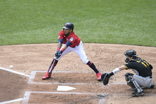 Eddie Rosario reached over the plate for an opposite field single in the first inning Tuesday at Target Field.