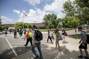 School districts across Minnesota are announcing their plans to reopen for the new year. Here, students walked between the portable classrooms and the