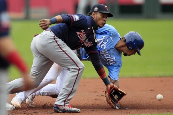Kansas City Royals Adalberto Mondesi, back, steals second base behind Minnesota Twins shortstop Jorge Polanco during the first inning of a baseball ga