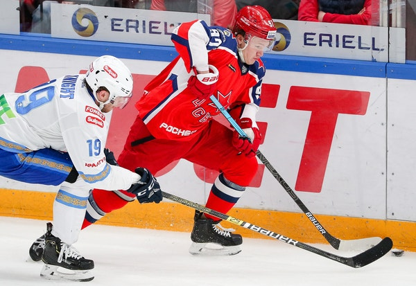Barys Nur-Sultan's Corban Knight, left, and CSKA Moscow's Kirill Kaprizov battle during a KHL game on Feb. 13 in Moscow.
