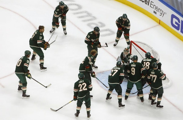 It's a good bet that not all of these Wild players, warming up before a playoff game with Vancouver last week, will be with the team next season.