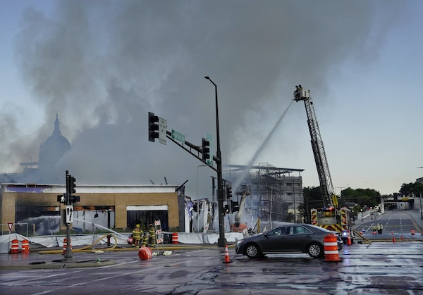 Fire ripped through a $69 million project hotel/apartment project early Tuesday morning, causing massive damage near the Xcel Energy Center in St. Pau