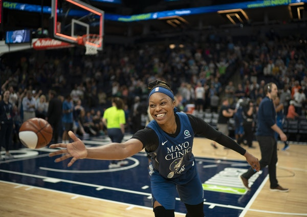 Minnesota Lynx guard Odyssey Sims (1) tossed a miniature ball to a fan courtside after the Lynx won with her 17 point effort. ] JEFF WHEELER • jeff.