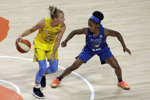 Chicago Sky guard Courtney Vandersloot (22) works against Minnesota Lynx guard Crystal Dangerfield (2) during the first half of a WNBA basketball game
