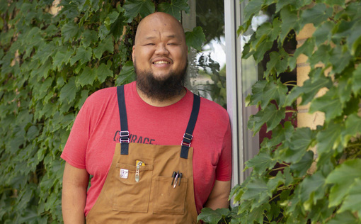 Yia Vang stands in front of the new location for his forthcoming brick-and-mortar restaurant, Vinai, which celebrates food from his family's Hmong heritage.