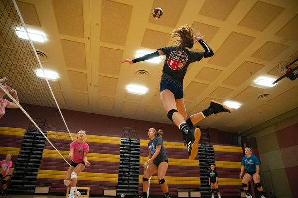 Jordan Mitchell jumped up for a spike during Denfeld High School volleyball practice on Tuesday.