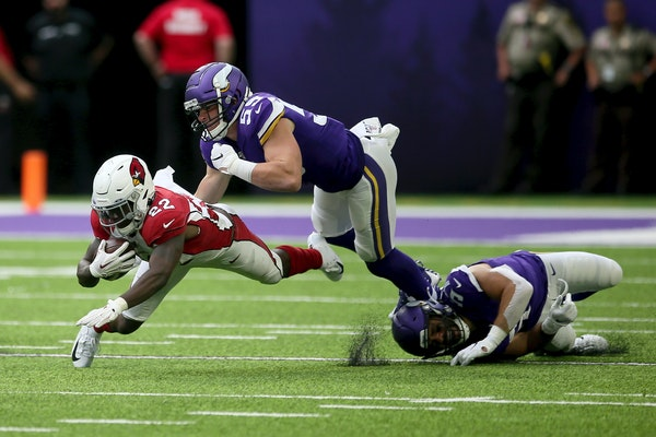 Cardinals running back T.J. Logan runs from Vikings linebacker Cameron Smith during the second half of a preseason game last season