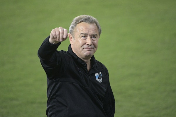 Minnesota United coach Adrian Heath waved to fans in the stands from the field in Orlando before a match against Orlando City on March 10, 2018.