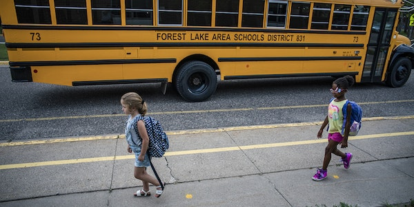 Children arrive for classes at Forest View Elementary, where social distancing is enforced. Kids are back to school. Sort of. In what could be a previ