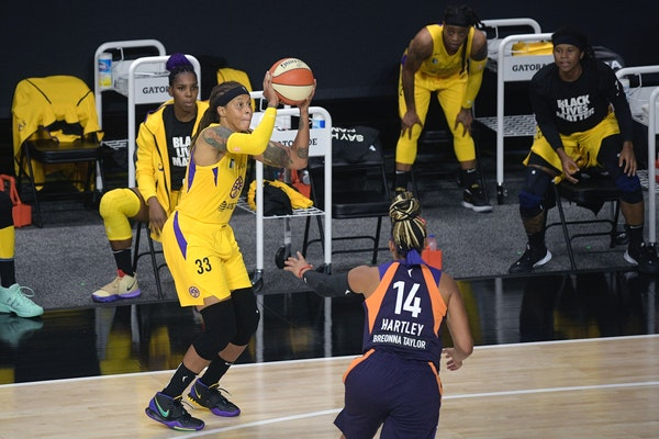 Los Angeles Sparks forward Seimone Augustus shoots a basket during the second half of a WNBA game against the Mercury