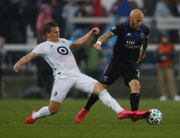 San Jose Earthquakes' Magnus Eriksson (7) keeps the ball away from Minnesota United FC's Robin Lod, left, in the first half of a game March 7.