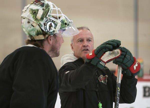 Wild coach Dean Evason talked with goalie Devan Dubnyuk during a team practice on July 13 in St. Paul.
