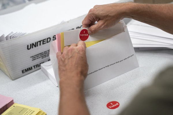 Todd Gallagher prepared mail-in ballots in July in Minneapolis.