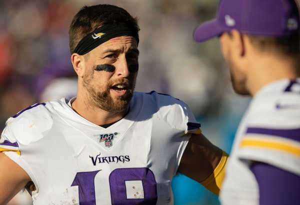 Adam Thielen, back, is the Vikings' senior receiver at age 29 and preeminent pass catcher