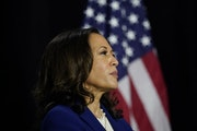 Democratic presidential candidate former Vice President Joe Biden's running mate Sen. Kamala Harris, D-Calif., looks to him during a campaign event at