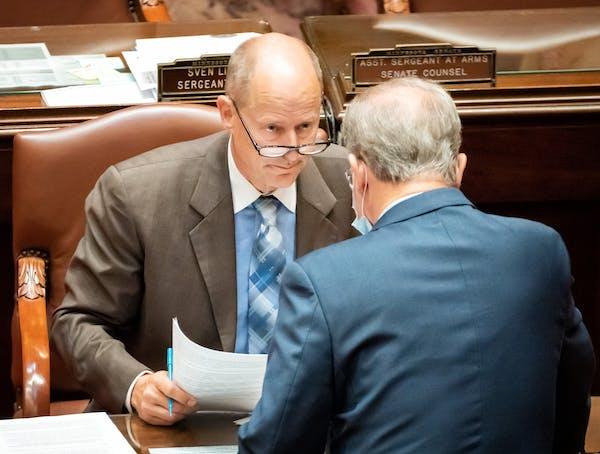 Senate Majority Leader Paul Gazelka, R-East Gull Lake, talked with fellow Republican Sen. Warren Limmer, R-Maple Grove, on Wednesday at the start of t