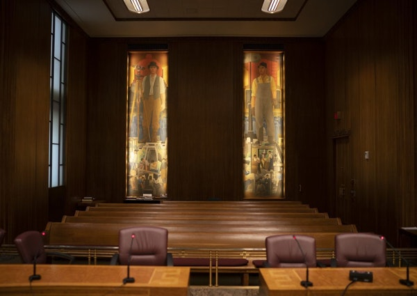Two of the four murals in the St. Paul City Council Chambers painted in 1933 by John Norton.