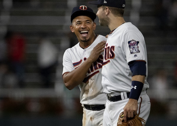 Minnesota Twins Eduardo Escobar and Brian Dozier celebrated at the end of the game.
